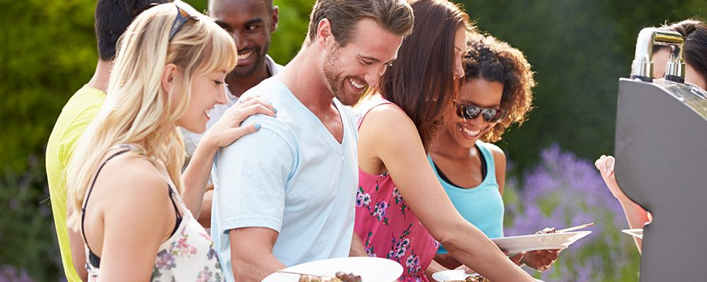 photo of people having bbq outside in summer